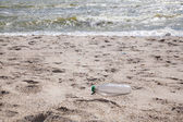 Trash on the sea beach — Stock Photo