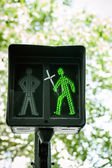Green traffic light with religious cross — Stock Photo