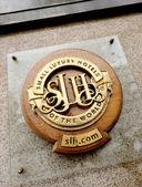 Small luxury hotel logo — Stock Photo