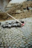 Pick axe near granite blocks — Stock Photo