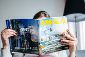 Reading IKEA Catalogue — Stock Photo