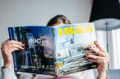 Reading IKEA Catalogue — Stockfoto