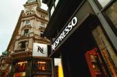 Nespresso store logo on a shopping street in Vienna, Austria — Stock Photo