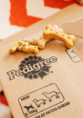 Pedigree box with dog food on top — Stock Photo