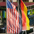 American and German flags waving on a clear summer day — Stock Photo #75157351