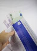 Hand holding Tax Free envelope — Stock Photo