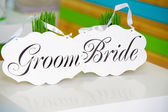 Wedding bride and groom signs — Stock Photo