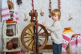 Little boy near spinning wheel — Stockfoto