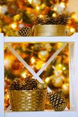 Decorative cones  near Christmas tree — Stockfoto