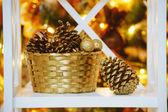 Decorative cones  near Christmas tree — Foto Stock