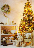 Teddy bears under Christmas tree — Stock Photo