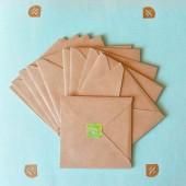 Stack of envelopes on blue — Stock Photo