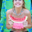 Woman with watermelon laughing sincerely — Stock Photo #82360928