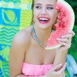 Gorgeous laughing young woman with watermelon slice — Stock Photo #83224452