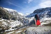 Sitting woman at a snow valley — Stock Photo