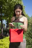 Surprised happy woman with shopping bag — Stock Photo