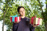 Woman choosing gift — Stock Photo