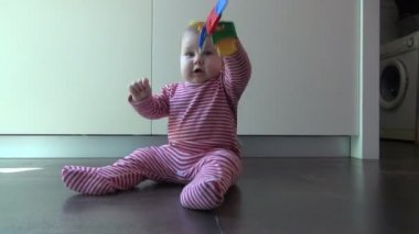 Baby playing with plastic keys — Stock Video