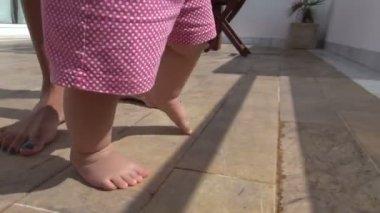 Baby with polka dot shorts walking — Stock Video
