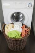 Clothes in laundry basket — Stock Photo