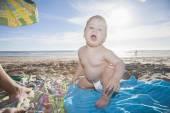 Backlighting baby at beach — Stock Photo