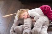 Happy baby embraced elephant plush — Stock Photo