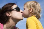 Baby and mom kissing — Stock Photo