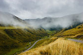 Mountains under mist in the morning — Foto Stock