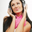 Young beautiful woman with headphones enjoying the music over white background — Stock Photo #55592221
