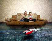 Young boy and girl with radio control. Playing with RC boat — Stock Photo