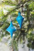 Christmas blue balls on fir branch — Stock Photo