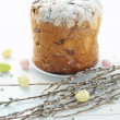 Easter composition with eggs holiday cake and willow branches on wooden table — Stock Photo #65440319