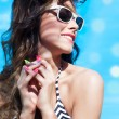 Woman wearing sunglasses and wrist watch — Stok fotoğraf