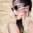 Постер, плакат: Woman wearing sunglasses and wrist watch