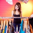 Woman searching for clothing in a closet — Stock Photo #53646955