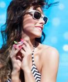 Woman wearing sunglasses and wrist watch — Foto de Stock