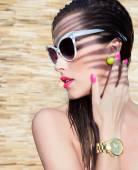Woman wearing sunglasses and wrist watch — Stock Photo