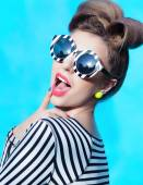 Woman wearing stripy sunglasses — Stock Photo