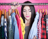 Surprised woman searching for clothing — Stock Photo