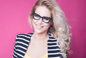 Attractive blonde woman wearing glasses — Stock Photo