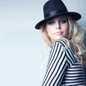 Woman wearing hat and stripy top — Stock Photo