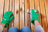 Painting wooden floor — Stock Photo