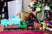 Model train with Xmas tree and gifts — Stock Photo