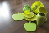 Green dishes on a dark wooden parquet — Foto Stock