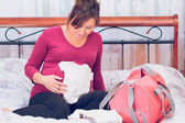 Pregnant woman packing hospital bag preparing for labor — Stock Photo