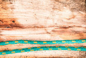 Rope on wooden surface — Stockfoto