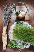 Easter composition of catkins, eggs and cress on wooden table — Stock Photo
