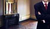 Man standing inside luxury royal palace interior — 图库照片