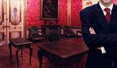 Man standing inside luxury royal palace interior — Zdjęcie stockowe