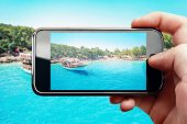 Chytrý telefon fotografie na paradise island — Stock fotografie